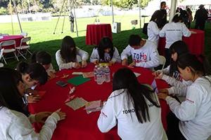 Students folding paper cranes